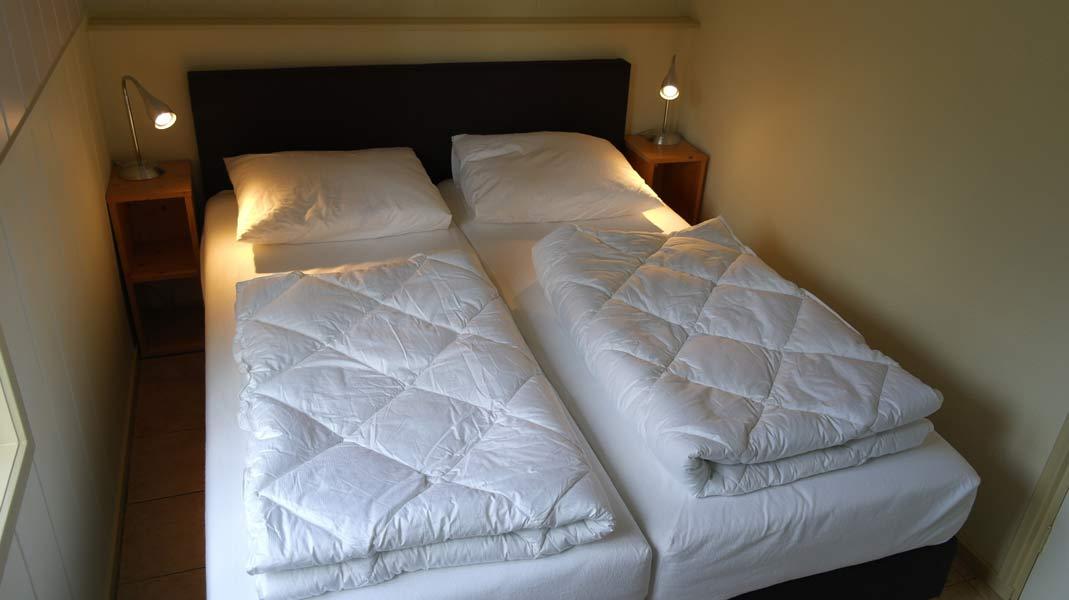 Het Roodborstje - slaapkamer | Romantische lodge voor 4 personen | Veluwe Lodges Otterlo